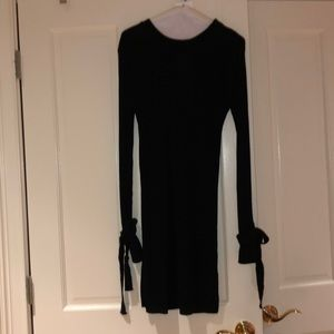 Black sweater dress with ties on sleeve